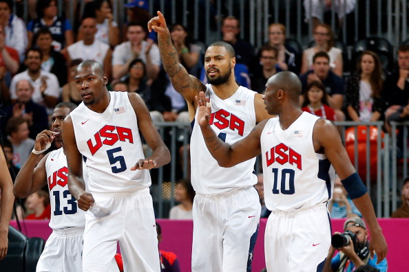 LONDON, ENGLAND - JULY 29: Kevin Durant #5 of United States celebrates with Tyson Chandler #4 and Kobe Bryant #10 after a play against France during their Men's Basketball Game on Day 2 of the London 2012 Olympic Games at the Basketball Arena on July 29, 2012 in London, England.  (Photo by Jamie Squire/Getty Images)
