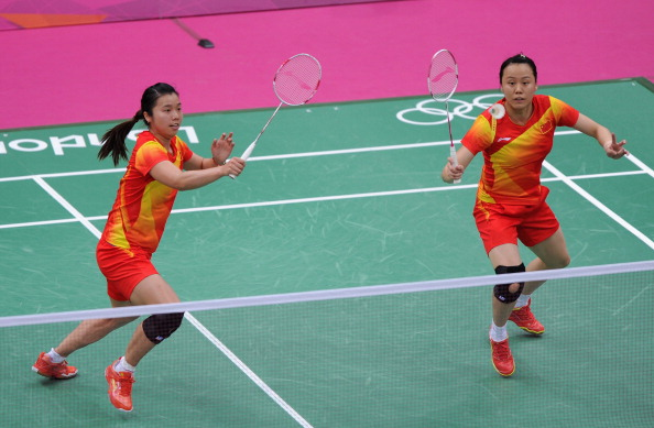 LONDON, ENGLAND - JULY 31:  Yunlei Zhao (R) and Qing Tian of China compete during their Women's Doubles Badminton match against Christinna Pedersen and Kamilla Rytter Juhl of Denmark on Day 4 of the London 2012 Olympic Games at Wembley Arena on July 31, 2012 in London, England.  (Photo by Michael Regan/Getty Images)