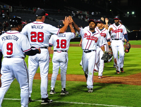 ATLANTA, GA - JULY 31: Members of the Atlanta Braves celebrate after the game against the Miami Marlins at Turner Field on July 31, 2012 in Atlanta, Georgia. (Photo by Scott Cunningham/Getty Images)