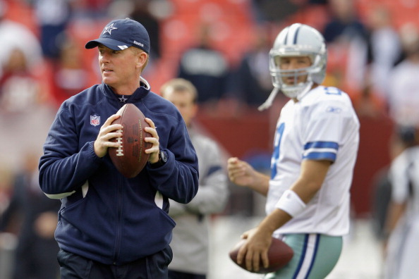 LANDOVER, MD - NOVEMBER 20: Head coach Jason Garrett (L) and Tony Romo #9 of the Dallas Cowboys look on as the Cowboys warm up before the start of their game against the Washington Redskins at FedExField on November 20, 2011 in Landover, Maryland.  (Photo by Rob Carr/Getty Images)