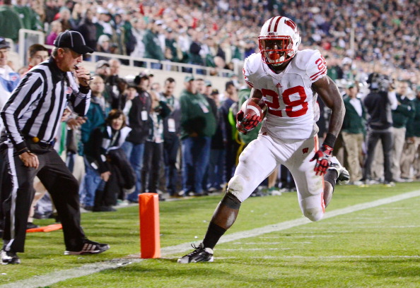 EAST LANSING, MI - OCTOBER 22:  Montee Ball #28 of the Wisconsin Badgers scores a game-tying touchdown in the fourth quarter against the Michigan State Spartans at Spartan Stadium on October 22, 2011 in East Lansing, Michigan. The Spartans defeated the Badgers 37-31 on the final play of the game.  (Photo by Mark Cunningham/Getty Images)