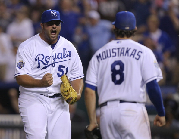 KANSAS CITY, MO - MAY 3:  Jonathan Broxton #51 and Mike Moustakas #8 of the Kansas City Royals celebrate a 4-3 win over the New York Yankees at Kauffman Stadium May 3, 2012 in Kansas City, Missouri. (Photo by Ed Zurga/Getty Images)