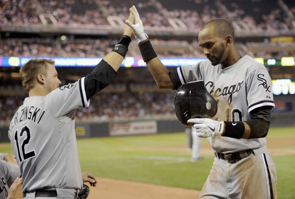 MINNEAPOLIS, MN - JULY 30: A.J. Pierzynski #12 of the Chicago White Sox congratulates Alexei Ramirez #10 on scoring against the Minnesota Twins during the eighth inning on July 30, 2012 at Target Field in Minneapolis, Minnesota. The Twins defeated the White Sox 7-6. (Photo by Hannah Foslien/Getty Images)