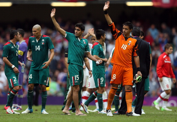 CARDIFF, WALES - AUGUST 01:  Nestor Vidrio (15) of Mexico and goalkeeper, Jose Rodriguez of Mexico thank the support after the Men's Football first round Group B match between Mexico and Switzerland on Day 5 of the London 2012 Olympic Games at Millennium Stadium on August 1, 2012 in Cardiff, Wales.  (Photo by Julian Finney/Getty Images)