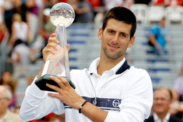 MONTREAL, QC - AUGUST 14:  Novak Djokovic of Serbia poses for photographers after defeating Mardy Fish of the United States in the final of the Rogers Cup at Uniprix Stadium on August 14, 2011 in Montreal, Quebec, Canada.  (Photo by Matthew Stockman/Getty Images)