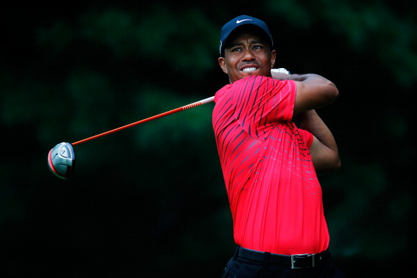 AKRON, OH - AUGUST 05:  Tiger Woods plays his shot on the second tee during the final round of the World Golf Championships-Bridgestone Invitational at Firestone Country Club South Course on August 5, 2012 in Akron, Ohio.  (Photo by Gregory Shamus/Getty Images)