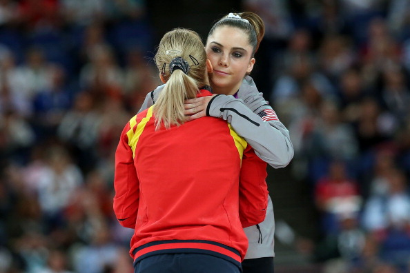LONDON, ENGLAND - AUGUST 05:  Silver medalist Mc Kayla Maroney (R) of the United States greets gold medalist Sandra Raluca Izbasa of Romania during the medal ceremony following the Artistic Gymnastics Women's Vault final on Day 9 of the London 2012 Olympic Games at North Greenwich Arena on August 5, 2012 in London, England.  (Photo by Ronald Martinez/Getty Images)
