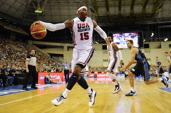BARCELONA, SPAIN - JULY 22: Carmelo Anthony #15 of the US Men's Senior National Team runs the ball during a Pre-Olympic Men's Exhibition Game between USA and Argentina at Palau Sant Jordi, on July 22, 2012 in Barcelona, Spain.  (Photo by David Ramos/Getty Images)