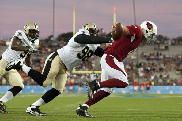 CANTON, OH - AUGUST 5: Defensive tackle Sedrick Ellis #98 of the New Orleans Saints tackles quarterback Kevin Kolb #4 of the Arizona Cardinals during first quarter of the Pro Football Hall of Fame game at Fawcett Stadium on August 5, 2012 in Canton, Ohio. Kolb was injured on the play and left the game. (Photo by Jason Miller/Getty Images)