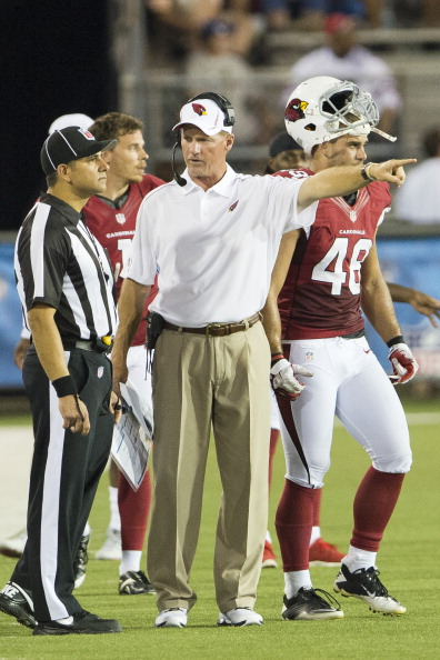 CANTON, OH - AUGUST 5: Line Judge Esteban Barza (L), talks with  head coach Ken Whisenhunt of the Arizona Cardinals during the second half of the Pro Football Hall of Fame game at Fawcett Stadium on August 5, 2012 in Canton, Ohio. The Saints defeated the Cardinals 17-10. (Photo by Jason Miller/Getty Images)