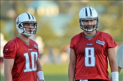 July 29, 2012; Nashville, TN, USA; Tennessee Titans quarterbacks Jake Locker (10) and Matt Hasselbeck (8) talk during training camp workout at the Titans training facility at Baptist Sports Park. Mandatory Credit: Jim Brown-US PRESSWIRE