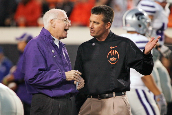 STILLWATER, OK - NOVEMBER 5:  Head Coach Bill Snyder of  the Kansas State Wildcats and Head Coach Mike Gundy of the Oklahoma State Cowboys talk before the game on November 5, 2011 at Boone Pickens Stadium in Stillwater, Oklahoma.  Oklahoma State defeated Kansas State 52-45.  (Photo by Brett Deering/Getty Images)