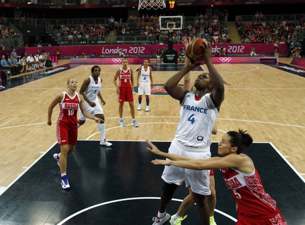 LONDON - AUGUST 5:  Isabelle Yacoubou of France shoots against Russia during their women's preliminary round Group B basketball match on Day 8 of the London 2012 Olympic Games at Basketball Arena on August 5, 2012 in London, England.  (Photo by Sergio Perez - IOPP Pool /Getty Images)