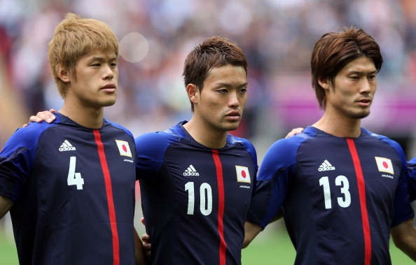 LONDON, ENGLAND - AUGUST 07:  Hiroki Sakai of Japan, Keigo Higashi of Japan and Daisuke Suzuki of Japan look on during the Men's Football Semi Final match between Mexico and Japan, on Day 11 of the London 2012 Olympic Games at Wembley Stadium on August 7, 2012 in London, England.  (Photo by Julian Finney/Getty Images)