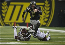 Oct 15, 2011; Eugene, OR, USA;  Oregon Ducks quarterback Bryan Bennett (2) breaks free for a long gain against the Arizona State Sun Devils during the second half at Autzen Stadium. The Ducks beat the Sun Devils 41-27. Mandatory Credit: Jim Z. Rider-US PRESSWIRE.
