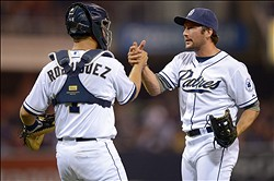 Aug 6, 2012; San Diego, CA, USA; San Diego Padres relief pitcher Huston Street (right) shakes hands with catcher Eddy Rodriguez (1) after the Padres beat the Chicago Cubs 2-0 at Petco Park. Mandatory Credit: Jake Roth-US PRESSWIRE