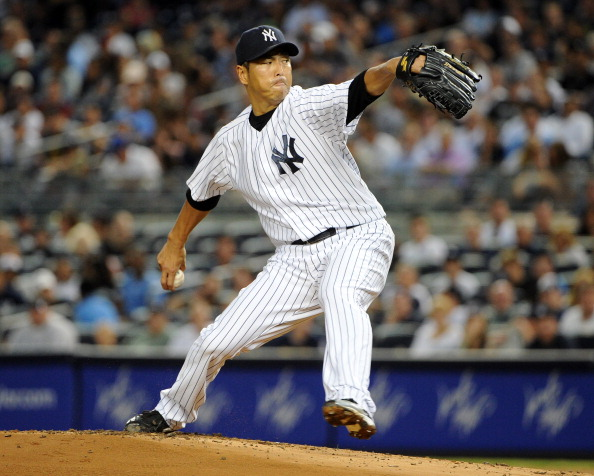 NEW YORK, NY - JULY 29: Hiroki Kuroda #18 of the New York Yankees throws a pitch during the game against the Boston Red Sox at Yankee Stadium on July 29, 2012 in the Bronx borough of New York City. (Photo by Christopher Pasatieri/Getty Images)