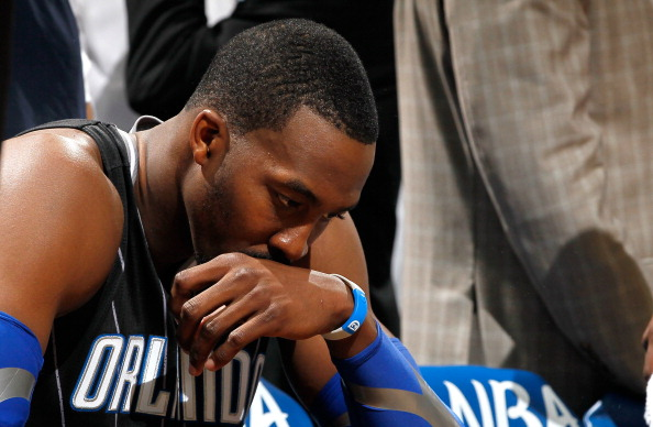 ATLANTA, GA - APRIL 28:  Dwight Howard #12 of the Orlando Magic sits on the bench during a timeout before the final seconds against the Atlanta Hawks during Game Six of the Eastern Conference Quarterfinals in the 2011 NBA Playoffs at Philips Arena on April 28, 2011 in Atlanta, Georgia.  NOTE TO USER: User expressly acknowledges and agrees that, by downloading and or using this photograph, User is consenting to the terms and conditions of the Getty Images License Agreement.  (Photo by Kevin C. Cox/Getty Images)