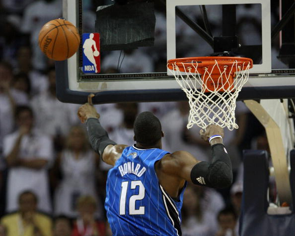CHARLOTTE - APRIL 24:  Center Dwight Howard #12 of the Orlando Magic blocks a shot during Game Three of the Eastern Conference Quarterfinals against the Charlotte Bobcats during the 2010 NBA Playoffs at Time Warner Cable Arena on April 24, 2010 in Charlotte, North Carolina. NOTE TO USER: User expressly acknowledges and agrees that, by downloading and/or using this photograph, user is consenting to the terms and conditions of the Getty Images License Agreement.  The Magic beat the Bobcats 90-86.  (Photo by Mike Zarrilli/Getty Images)
