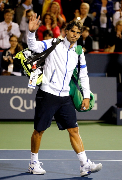 MONTREAL, QC - AUGUST 10:  Rafael Nadal of Spain leaves the court after loosing to Ivan Dodig of Croatia during the Rogers Cup at Uniprix Stadium on August 10, 2011 in Montreal, Canada.  (Photo by Matthew Stockman/Getty Images)