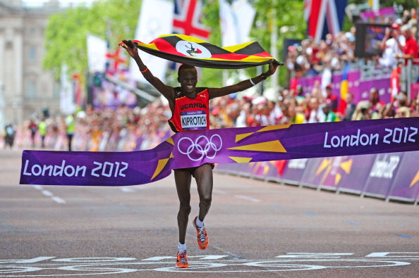 LONDON, ENGLAND - AUGUST 12:  Stephen Kiprotich of Uganda celebrates as he approaches the line to win gold in the Men's Marathon on Day 16 of the London 2012 Olympic Games at The Mall on August 12, 2012 in London, England.  (Photo by Stu Forster/Getty Images)