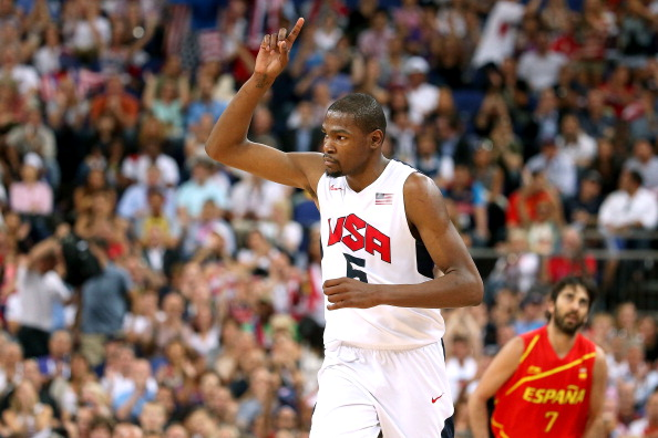 LONDON, ENGLAND - AUGUST 12:  Kevin Durant #5 of the United States celebrates making a three point shot during the Men's Basketball gold medal game between the United States and Spain on Day 16 of the London 2012 Olympics Games at North Greenwich Arena on August 12, 2012 in London, England.  (Photo by Christian Petersen/Getty Images)