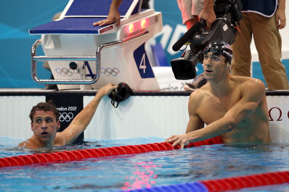 LONDON, ENGLAND - AUGUST 02:  Gold medallist Michael Phelps (R) of the United States looks on along with silver medallist Ryan Lochte (L) of the United States following the Men's 200m Individual Medley final on Day 6 of the London 2012 Olympic Games at the Aquatics Centre on August 2, 2012 in London, England.  (Photo by Ezra Shaw/Getty Images)