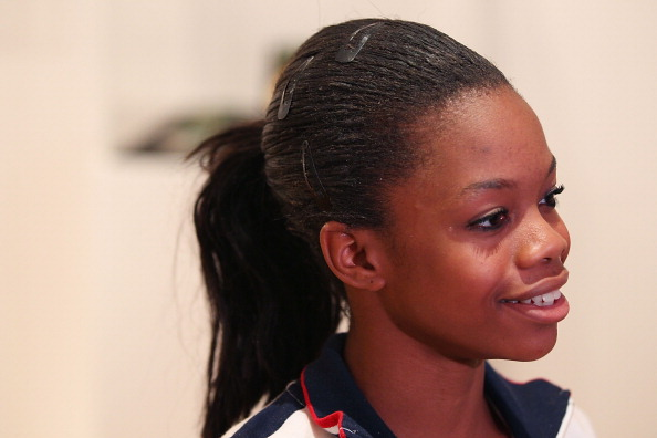 LONDON, ENGLAND - AUGUST 07:  U.S. Olympian Gabrielle Douglas visits the USA House at the Royal College of Art on August 7, 2012 in London, England.  (Photo by Joe Scarnici/Getty Images for USOC)
