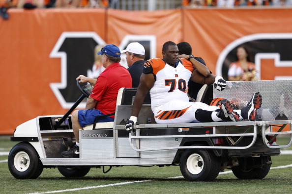 CINCINNATI, OH - AUGUST 10: Travelle Wharton #70 of the Cincinnati Bengals gets carted off the field after suffering an injury against the New York Jets during a preseason NFL game at Paul Brown Stadium on August 10, 2012 in Cincinnati, Ohio. (Photo by Joe Robbins/Getty Images)