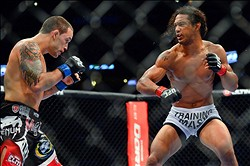 August 11, 2012; Denver, CO, USA; Benson Henderson (right) fights Frankie Edgar (left) during UFC 150 at the Pepsi Center. Mandatory Credit: Ron Chenoy-US PRESSWIRE