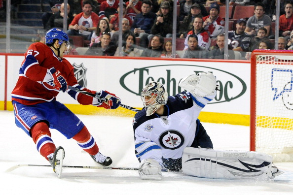 MONTREAL, CANADA - FEBRUARY 5:  Ondrej Pavelec #31 of the Winnipeg Jets stops the puck on an attempt by Max Pacioretty #67 of the Montreal Canadiens during the NHL game at the Bell Centre on February 5, 2012 in Montreal, Quebec, Canada.  (Photo by Richard Wolowicz/Getty Images)