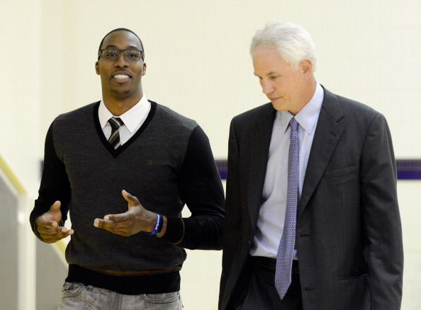 EL SEGUNDO, CA - AUGUST 10:  Dwight Howard (L) walks with General Manager Mitch Kupchak of the Los Angeles Lakers being introduced as the newest member of the Lakers at a news conference at the Toyota Sports Center on August 10, 2012 in El Segundo, California. The Lakers aquired Howard from Orlando Magic in a four-team trade. In addition Lakers wil receive Chris Duhon and Earl Clark from the Magic.  (Photo by Kevork Djansezian/Getty Images)
