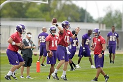 Jul 27, 2012; Mankato, MN, USA; Minnesota Vikings quarterback Sage Rosenfels (18) passes amidst quarterback McLeod Bethel-Thompson (4) and quarterback Joe Webb (14) and quarterback Christian Ponder (7) in drills at training camp at Blakeslee Stadium at Minnesota State University, Mankato. Mandatory Credit: Bruce Kluckhohn-US PRESSWIRE