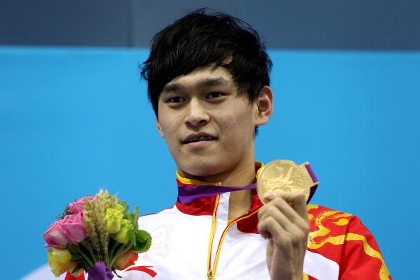 LONDON, ENGLAND - AUGUST 04:  Gold medallist Yang Sun of China poses on the podium during the medal ceremony for the Men's 1500m Freestyle Final on Day 8 of the London 2012 Olympic Games at the Aquatics Centre on August 4, 2012 in London, England.  (Photo by Clive Rose/Getty Images)