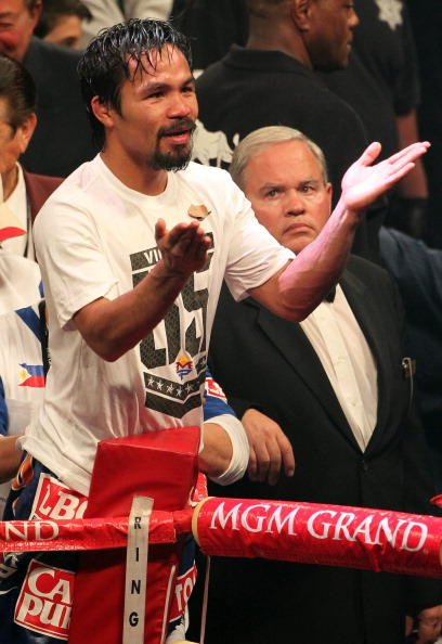 LAS VEGAS, NV - JUNE 09:  Manny Pacquiao salutes the crowd after his fight against Timothy Bradley at MGM Grand Garden Arena on June 9, 2012 in Las Vegas, Nevada.  (Photo by Jeff Bottari/Getty Images)