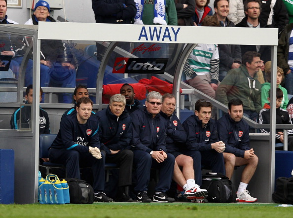 LONDON, ENGLAND - MARCH 31:  Arsenal manager Arsene Wenger (second left) assistant manager Pat Rice (C) and staff look on during the Barclays Premier League match between Queens Park Rangers and Arsenal at Loftus Road on March 31, 2012 in London, England.  (Photo by Ian Walton/Getty Images)