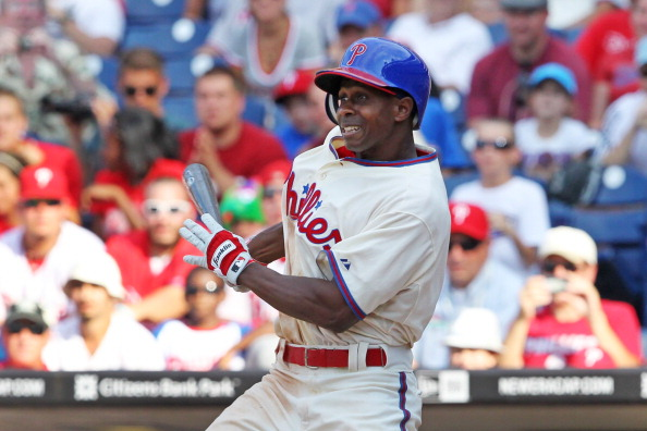 PHILADELPHIA - AUGUST 12: Juan Pierre #10 of the Philadelphia Phillies hits a game winning walk-off infield single during a game against the St. Louis Cardinals at Citizens Bank Park on August 12, 2012 in Philadelphia, Pennsylvania. The Phillies won 8-7. (Photo by Hunter Martin/Getty Images)