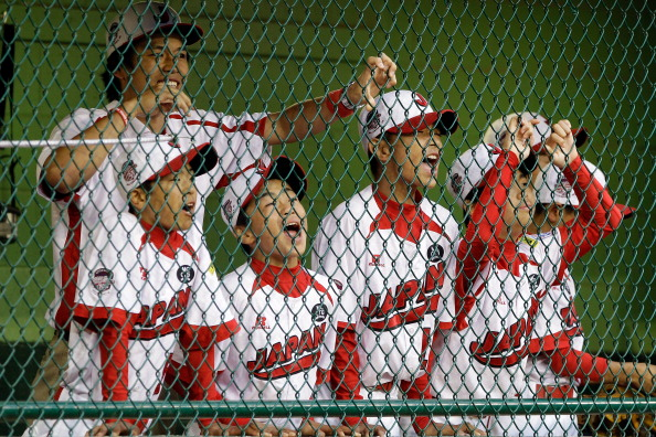 SOUTH WILLIAMSPORT, PA - AUGUST 28: Members of the Japan team from Hamamatsu City, Japan cheer on their team from the dugout against the West team from Huntington Beach, California during the Little League World Series championship game on August 28, 2011 in South Williamsport, Pennsylvania. The West team defeated the team from Japan 2-1. (Photo by Rob Carr/Getty Images)
