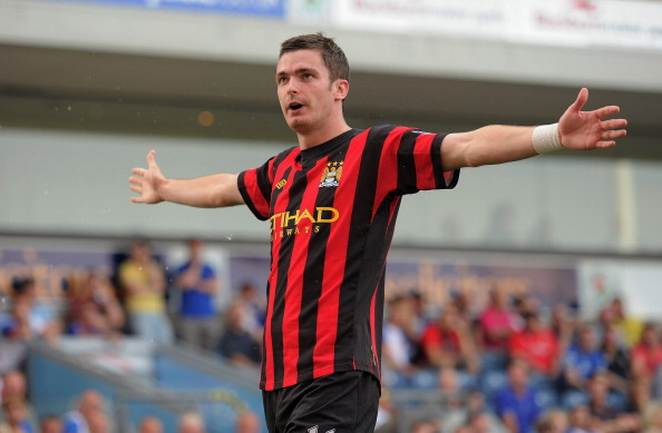 BLACKBURN, ENGLAND - OCTOBER 01: Adam Johnson of Manchester City celebrates after scoring the opening goal of the Barclays Premier League match between Blackburn Rovers and Manchester City at Ewood Park on October 1, 2011 in Blackburn, England.  (Photo by Michael Regan/Getty Images)