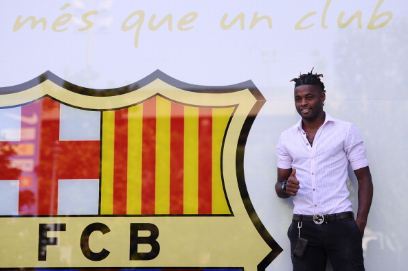 BARCELONA, SPAIN - AUGUST 20:  Alex Song poses for the photographers after signing for FC Barcelona at Camp Nou on August 20, 2012 in Barcelona, Spain.  (Photo by David Ramos/Getty Images)