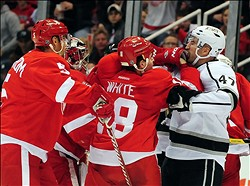 Dec 17, 2011; Detroit, MI, USA; Detroit Red Wings defenseman Ian White (18) gets in a fight with Los Angeles Kings right wing Trent Hunter (47) during the second period at Joe Louis Arena. Mandatory Credit: Andrew Weber-US PRESSWIRE
