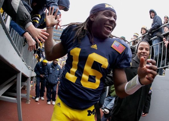ANN ARBOR, MI - NOVEMBER 19: Denard Robinson #16 of the Michigan Wolverines celebrates a 45-17 victory over the Nebraska Cornhuskers at Michigan Stadium on November 19, 2011 in Ann Arbor, Michigan. (Photo by Gregory Shamus/Getty Images)