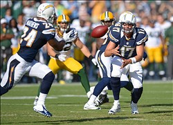 Aug 9, 2012; San Diego, CA, USA; San Diego Chargers quarterback Philip Rivers (17) pitches the ball out to running back Ryan Mathews (24) during the first quarter at Qualcomm Stadium. Mathews would leave the game for x-rays after the play and is expected to miss 4-6 weeks. Mandatory Credit: Jake Roth-US PRESSWIRE