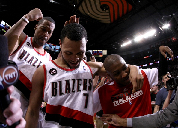 PORTLAND, OR - APRIL 23:  Brandon Roy #7 of the Portland Trail Blazers celebrates with teammates Marcus Camby #23 and Armon Johnson #1 after overcoming a 23 point deficit to defeat the of the Dallas Mavericks 84-82 in Game Four of the Western Conference Quarterfinals in the 2011 NBA Playoffs on April 23, 2011 at the Rose Garden in Portland, Oregon. NOTE TO USER: User expressly acknowledges and agrees that, by downloading and or using this photograph, User is consenting to the terms and conditions of the Getty Images License Agreement.  (Photo by Jonathan Ferrey/Getty Images)