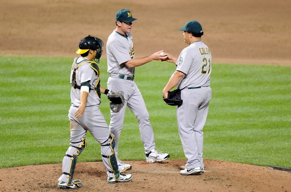 BALTIMORE, MD - JULY 28:  Bartolo Colon #21 of the Oakland Athletics is taken out of the game by manager Bob Melvin #6 in the sixth inning against the Baltimore Orioles at Oriole Park at Camden Yards on July 28, 2012 in Baltimore, Maryland.  (Photo by Greg Fiume/Getty Images)