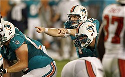 August 10, 2012; Miami Gardens, FL, USA;  Miami Dolphins quarterback Ryan Tannehill (17) calls a play against the Tampa Bay Buccaneers during the third quarter at Sun Life Stadium. Mandatory Credit: Robert Mayer-US PRESSWIRE
