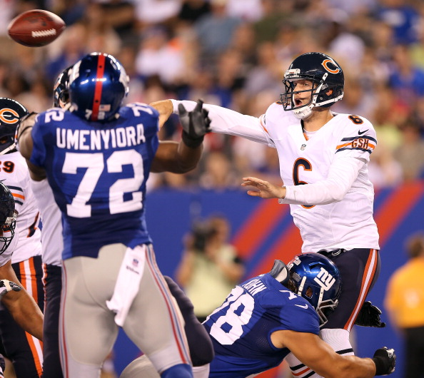 EAST RUTHERFORD, NJ - AUGUST 24:   Jay Cutler #6 of the Chicago Bears gets rid of the ball as  Markus Kuhn #78 of the New York Giants pressures during a preseason game on August 24, 2012 at MetLife Stadium in East Rutherford, New Jersey.  (Photo by Elsa/Getty Images)