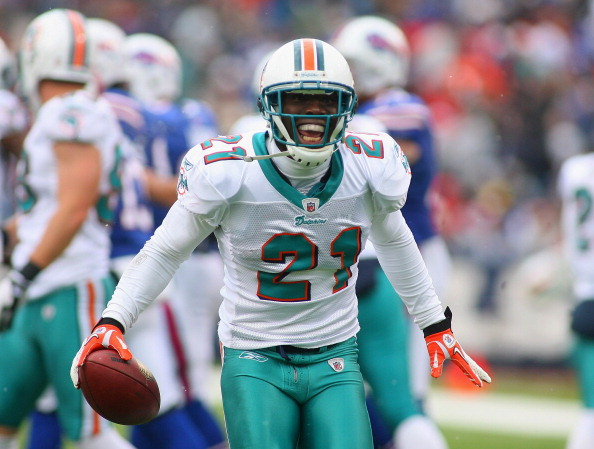 ORCHARD PARK, NY - DECEMBER 18:  Vontae Davis #21 of the Miami Dolphins celebrates his interception in the first half against the Buffalo Bills at Ralph Wilson Stadium  on December 18, 2011 in Orchard Park, New York.  (Photo by Rick Stewart/Getty Images)