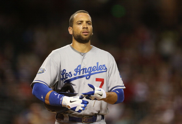 PHOENIX, AZ - JULY 05:  James Loney #7 of the Los Angeles Dodgers walks to the dugout during the MLB game against the Arizona Diamondbacks at Chase Field on July 5, 2012 in Phoenix, Arizona. The Dodgers defeated the Diamondbacks 4-1.  (Photo by Christian Petersen/Getty Images)
