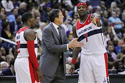 March 7, 2012; Washington, DC, USA; Washington Wizards head coach Randy Wittman (c) talks with power forward Andray Blatche (7) and guard Shelvin Mack (22) during a stoppage in play against the Los Angeles Lakers in the second half at Verizon Center. The Wizards won 106-101. Mandatory Credit: Geoff Burke-US PRESSWIRE